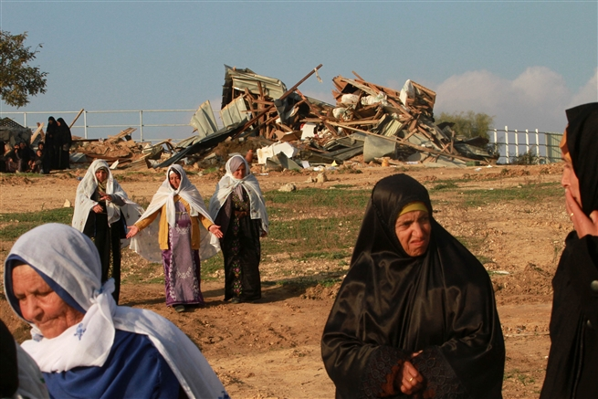 Bedouin women next to a demolished house in the village of Umm al-Hiran, Israel, January, 2017.