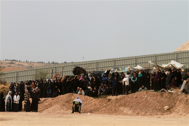 Bedouin women mourn during a funeral in the village of Umm al-Hiran, Israel, January, 2017.