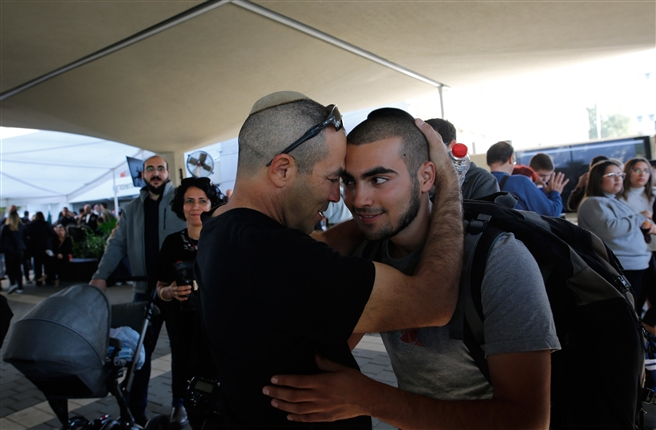 Israeli youth get bless from his father enlistment day,Tel Hashomer, November 2018