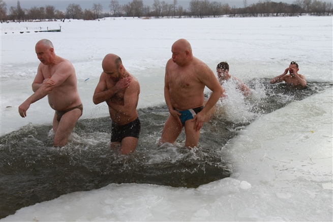 Orthodox plunge into the icy water of Dnipro river Epiphany, Kiev,January 2016