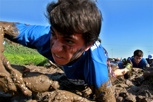 Israeli youths crawl in the mud training for the Israeli Army February 2016
